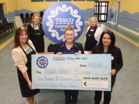 Collette Price of Tralee Soup Kitchen accepts a cheque from Tesco Manor West Store Champion Louise O'Connor and Store Manager Anna O'Sullivan with, at back Mary Dolan and Kerry O'Connell from the Soup Kitchen. Photo by Dermot Crean