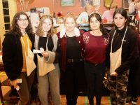 Victoria Pula, Sinead Forrest, Zuzanna Redlich, Emma Flanagan and Larisa Vicente helping out at the first night of the St John's Bazaar in the KDYS on Friday night. Photo by Dermot Crean