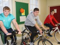 Students Kian Ó Riagain, Peadar Tóibín, and Lennox Beaujouan taking part in the Spinathon as part of Mental Health Week at Gaelcholáiste Chiarraí. Photo by Dermot Crean