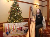 Eve Ní Chríodáin playing the harp at the Gaelcholáiste Chiarraí Christmas Cookery Demo in the Meadowlands Hotel on Thursday night. Photo by Dermot Crean