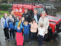 Students from St Ita's and St Joseph's School in Tralee with Principal Grave Sheahan, Tom Leslie of Killarney Vintage Club, Risteard Pierse of Down Syndrome Kerry, Maureen O'Brien of Recovery Haven at the school on Friday with the restored Land Rover to be raffled next weekend. Photo by Dermot Crean