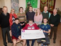 Presenting the cheque for €500 to St John Of God Tralee were, front from left;  Jonathan O'Halloran, Maggie O'Donnell and Michael Walsh. Back from left; Brendan Brosnan, Liz O'Donnell, Sarah O'Halloran, Stephen Walsh, Brenda McNamara, Denis Mannix and Hugh Fitzgibbon. Photo by Dermot Crean