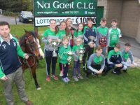 Eamonn Browne with 'Beauty' and members of Na Gaeil GAA Club launching their race night. Photo by Dermot Crean