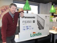 Niall Nolan with one of the four Panasonic TVs to be won at Nolan's Garage on North Circular Road between now and January 5. Photo by Dermot Crean