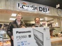 "Niall Nolan (left) presents a new 49"" Panasonic Smart LED TV to the first winner in their giveaway, Martin O'Sullivan from Castlemaine. Photo by Dermot Crean"