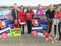 Martin Moore, Paige and Mags Quillinan, Aoife Moynihan, Maura Sullivan, Mary and Deirdre Moore with 'Jazz' launching the Santa Fun Run at Tralee Wetlands on Tuesday. Photo by Dermot Crean