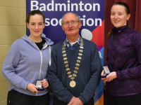Waterford County Association President Michael McGrath presents prizes to Ladies Grade D Doubles Champions Elaine Hudson (Moyvane) left and Maeve Twomey (Killarney) right at the Waterford Invitational Open last weekend.