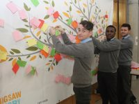 Oran Mullins, David Oba and Dionit Baftijari at the Jigsaw tree at CBS Tralee on Friday. Photo by Dermot Crean