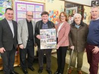 Jim O'Sullivan (third from left) receives a memento to mark his stepping down from the caretaker role at Gaelscoil Mhic Easmainn from Principal Cáit Uí Chonchúir. Also included is Fr Francis Nolan, two of the founders of the Gaelscoil Padraig Mac Fhearghusa and Sean Seosamh Ó Conchubhair and Leas Príomhoide Liam Ó Conchubhair. Photo by Dermot Crean