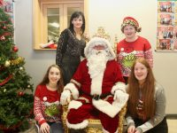 At back; Principal of Kerry College of Further Education Mary Lucey and Mary Tansley. In front; Grace O'Mahony and Mary Anne White with Santa at the KCFE 'Christmas On Campus' day on Thursday. Photo by Dermot Crean