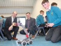 Labhrás Long (left) controls the robot with Principal of Mercy Mounthawk John O'Roarke (left) and John Walsh of IT Tralee (centre). Photo by Dermot Crean