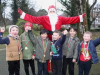 Santa with Moyderwell pupils taking part in the Jingle Bell Jog on Wednesday morning. Photo by Dermot Crean