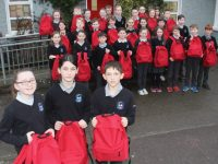 Scoil Nuachabháil pupils with the dignity packs they made up for homeless people.