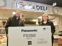 """Niall Nolan presents Catherine Kearns with her new 49"""" Panasonic LED Smart TV which she won in the Nolan's Londis draw. Photo by Dermot Crean"""