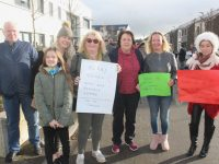 John O'Sullivan, Toireasa Ferris and daughter Liadain, Mags Knightly, Maura Walsh, Nicola Coffey and  Miriam Moriarty Owens at the protest on Saturday. Photo by Dermot Crean
