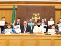 Cathaoirleach Cllr Norma Foley and Deputy Chief Executive, Charlie O'Sullivan with the winners of the annual Road Safety Calendar competition hosted by Kerry County Council.