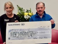 Michelle Greaney presents a cheque of €1,300 to Joe Hennebery of Kerry Hospice.