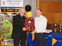 Canon Moss O'Connell, receiving his Hall of Fame honour from Aidan Behan.