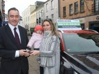Tara Flynn receives the keys of her new car from Pa Laide, CEO of Cara Credit Union. Photo by Dermot Crean
