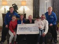 The Sugrue family of Belfield Nursery present the cheque to Kerry Hospice representatives.