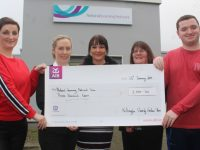 Fiona Hyde (left) and her son Dylan (right) present a cheque to Noelle O'Sullivan, Assistant Manager National Learning Network (NLN); Fiona Keogh, Area Manager NLN and Mary Behan Instructor NLN. Photo by Dermot Crean