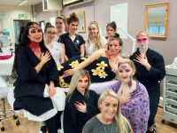 Instructor Tara O'Sullivan in front with Kerry ETB trainees and models taking part in the