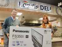 """Niall Nolan presents a new 49"""" Panasonic LED Smart TV to Stephanie Kerins, the latest winner in the TV giveaway competition. Photo by Dermot Crean"""