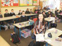 Teacher Maura O'Doherty with senior class pupils at St John's Parochial School. Photo by Dermot Crean