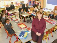 Acting Principal Patricia Fitzell with junior class pupils at St John's Parochial School. Photo by Dermot Crean