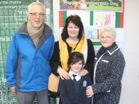 Saoirse O'Connor with grandparents Aidan O'Connor, Ann Crean and Dolores O'Connor at the St Brendan's NS Blennerville Grandparents Day on Wednesday. Photo by Dermot  Crean