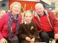 Aoibhe Healy with grandparents Helen and Dan Healy at the Gaelscoil Mhic Easmainn Grandparents Day on Friday. Photo by Dermot Crean