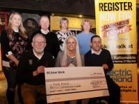 Con O'Connor (standing second from left) of Pieta House with the Tralee Darkness Into Light committee at the presentation of proceeds from last year's event. Front from left; Martin Brosnan, Marilyn O'Shea and Aidan O'Sullivan. Back from left; Stephanie Turner, Ann Leahy O'Shea and Pat Turner. Photo by Dermot Crean
