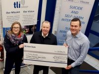 Con O'Connor (centre) accepts a cheque on behalf of Pieta House from Michelle Walsh and John Tuite.
