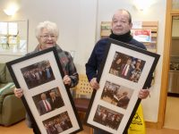 Ted Moynihan's wife Breda and son Simon with the photos. Photo by Dermot Crean