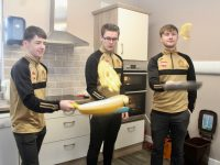 David Smith, Cian Lynch and Darragh Higson Spillane flipping pancakes in the 'Breakfast Club' kitchen at CBS The Green on Tuesday. Photo by Dermot Crean