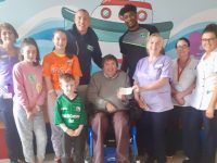 Club Chairman Terry O'Brien and Warriors players Kieran Donaghy and Keith Jumper present a cheque for €300.00 to the staff of the Cashel Children's Ward at University Hospital Kerry.