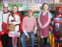 Teacher Ms O'Leary (seated) with Holy Family pupils dressed up as fictional characters for World Book Day on Thursday. Photo by Dermot Crean