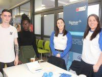 Students Richard Horgan and Marian Nambase speaking with Aisling O'Donovan and Laura Baker of Sigmar at the KCFE Recruitment Fair on Tuesday. Photo by Dermot Crean