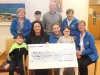 Paula Silles (front second left) presented a cheque for €2,700 to the Palliative Care Unit on Thursday evening. Also pictured is, front, from left; Oran Silles, Andrea O'Donoghue, Aimee Silles and Maura Sullivan At back; Margaret Crean, Luke Silles, Tony Silles and Bridie O'Connor. Photo by Dermot Crean