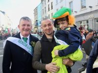 Grand Marshals Anthony O'Gara and young Ryan Kelliher being held by his dad Trevor. Photo by Dermot Crean