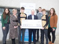 Con O'Connor of Pieta House receives a cheque for €662 from CBS The Green Principal Anne O'Callaghan with staff and students. Photo: Joe Hanley