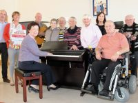 Looking forward to the upcoming fundraising concert at Baile Mhuire on Tuesday were, seated at piano Renee Fitzgibbon. Back; Aidan Kelly, Caroline Corkery, Gerry Cournane, Dolly Lawlor, Paula O'Shea, Leonie Heaslip, Eileen Daly, Trish White, John Moriarty and Michael McCarthy. Photo by Dermot Crean