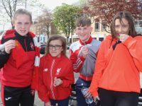 Kissing the crest...Liverpool fans Mollie Duggan, Saoirse Kerins, Jesse Duggan and Jamie Lee Duggan before heading to Dublin on Friday  afternoon. Photo by Dermot Crean