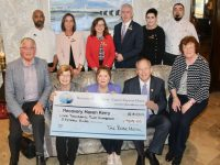 Eibhlin and Dick Henggeler (seated third and fourth from left) of The Rose Hotel present a cheque to Dermot Crowley, Maureen O'Brien and Phil Stack of Recovery Haven. Also included at back are Chef Jason Fabian, Madeleine Doyle (Conference and Banqueting Manager), Aisling Foley (Sales and Marketing Manager), Mark Sullivan (General Manager), Tara Cunningham (Serenity Spa Manager) and Chef Karl Noctor. Photo by Dermot Crean