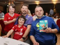 Declan Smith and Ken McMahon with youngsters Fionn and Kyle Smith at the Tralee Rugby Club Race Night at The Ashe Hotel on Friday night. Photo by Dermot Crean