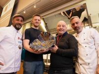 Denis Walsh receives his prize after winning the All-Ireland Tapas and Pintxo Championships in IT Tralee from Robert Curley. Also included are judges Gorka Arrieta and John Harty.
