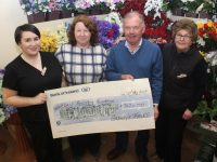 Joe Hennebery of Kerry Hospice accepts a cheque for €747 from Alison McGaley, Eileen O'Mahony and Anne Ahern of Guiney's, the proceeds of a coffee/fashion morning at the store last month. Photo by Dermot Crean