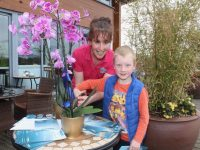 Young Dylan helps Mags O'Sullivan officially launch the 'Tralee By The Sea' brochure at Tralee Bay Wetlands on Tuesday. Photo by Dermot Crean