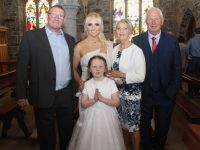 Presentation pupil Amberley O'Mahony with mom Kayleigh O'Mahony, grandparents Peter Ellis and Phil and Dan O'Mahony, at her First Holy Communion in St John's Church on Saturday morning. Photo by Dermot Crean