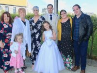 Communion girl Ally Kerins with parents Andrea and Chris, Marie Kelly, Stella Kerins, Amelia Kerins Brian Kerins and Emma Nash at the Scoil Eoin Balloonagh First Holy Communion Day at Our Lady and St Brendan's Church on Saturday.  Photo by Dermot Crean